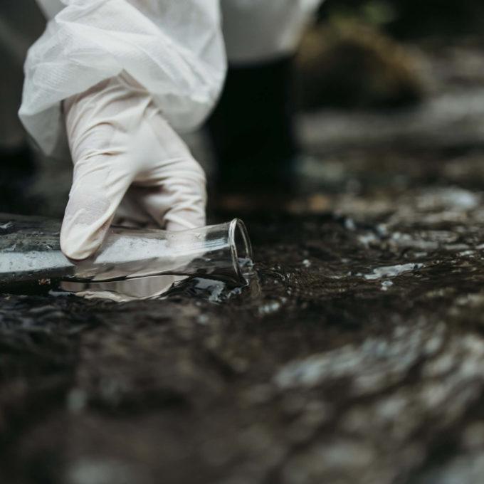 Environment Studies - Person taking samples in river