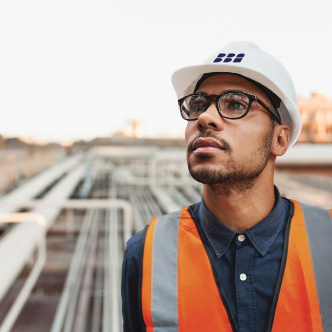 Man on construction site engineering