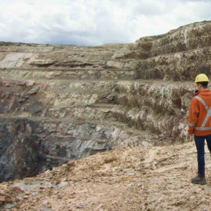 Mining - Mining engineer looking over mining pit
