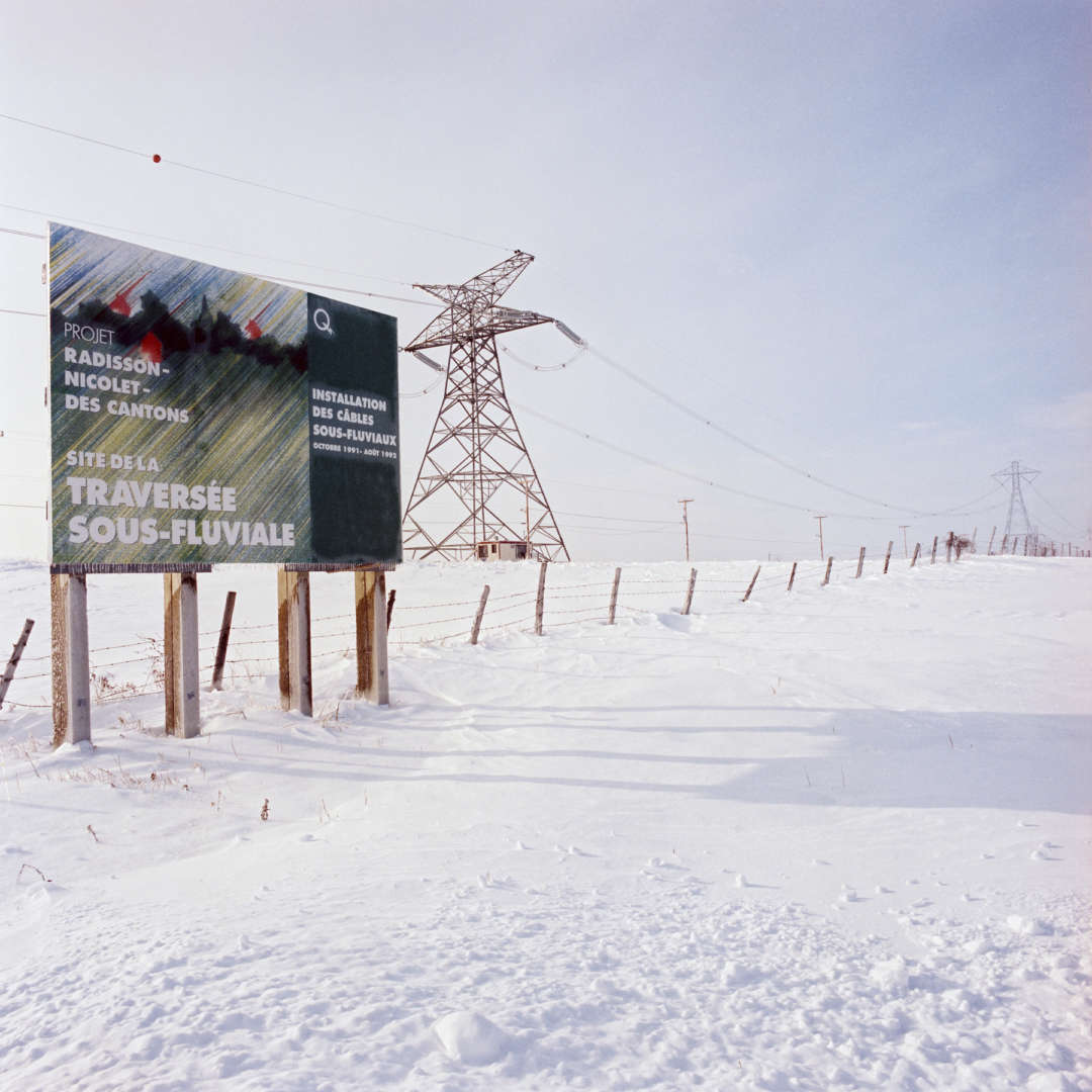 <p>Billboard announcing the construction of the underwater crossing, 1992</p> <p>©Hydro-Québec.</p>