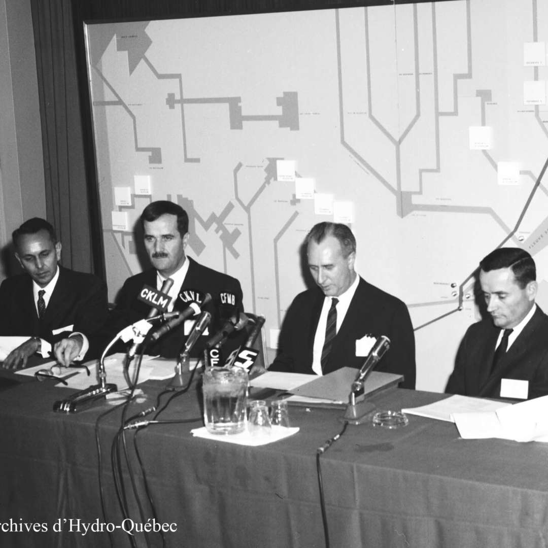 <p>Hydro-Québec engineers who played a pivotal role in the world's first 735-kV transmission line. From left to right: Jean-Jacques Archambault, Guy Monty, Benoît Baribeau and Lionel Cahill, September 1965.</p> <p>©Hydro-Québec archives.</p>