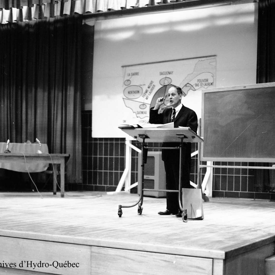 <p>Speech by René Lévesque (then Québec's Minister of Natural Resources) to Hydro-Québec staff on the nationalization of electricity, February 1963. </p> <p>©Hydro-Québec archives.</p>