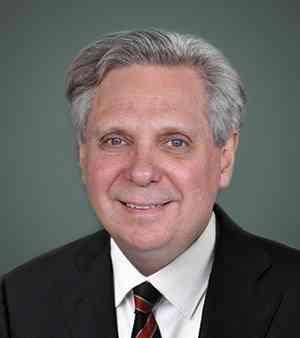 Dr. Mark Kristmanson