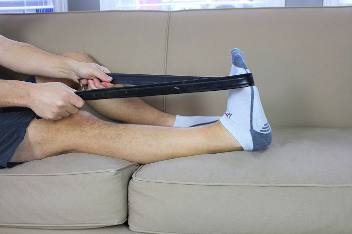 calf stretch with belt knee straight