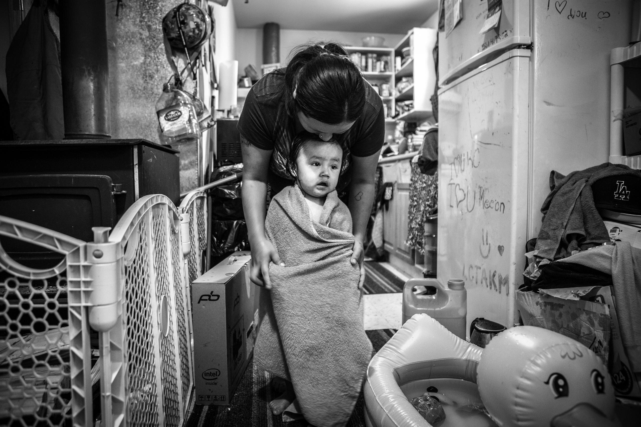 Chris Donovan, Casey Moonias with her son Meeson, Neskantaga First Nation, 2018