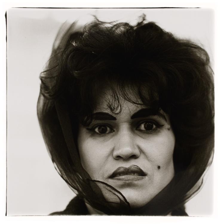 Diane Arbus, Puerto Rican woman with a beauty mark, N.Y.C., 1965. Gelatin silver print, sheet: 50.8 x 40.6 cm. Art Gallery of Ontario. Gift of Phil Lind, 2016. Copyright © Estate of Diane Arbus.