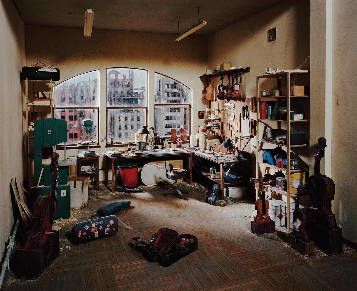 "Lori Nix and Kathleen Gerber, Violin Repair Shop, 2011. Chromogenic Print, 48 x 65"". Courtesy of Bau-Xi Photo."