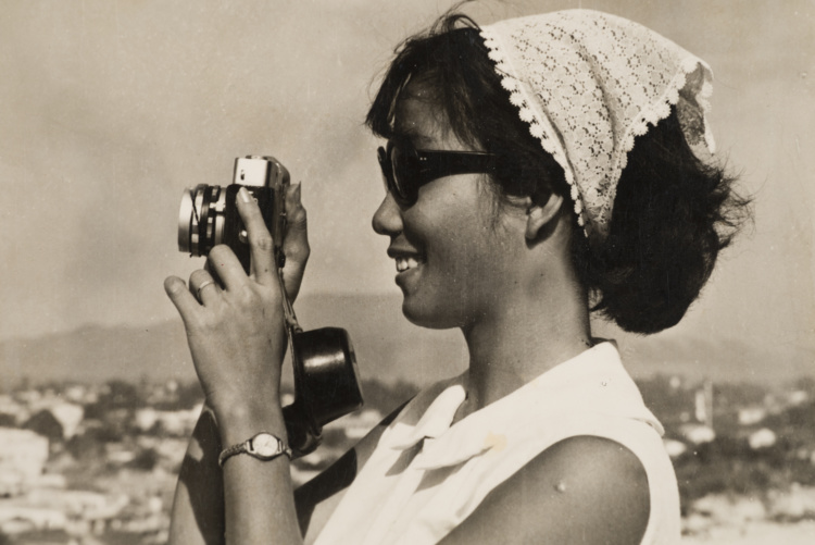 Sang Thai, Luong with a 35mm camera, Nha Trang, Khánh Hòa, Vietnam, 1962. Gelatin silver print. Courtesy of the Lu-Thai family.