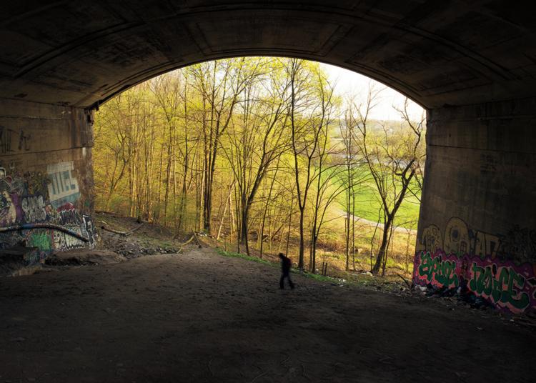 Robert Burley, Homeless man beneath the Prince Edward Viaduct, 2013. Courtesy of the Stephen Bulger Gallery.