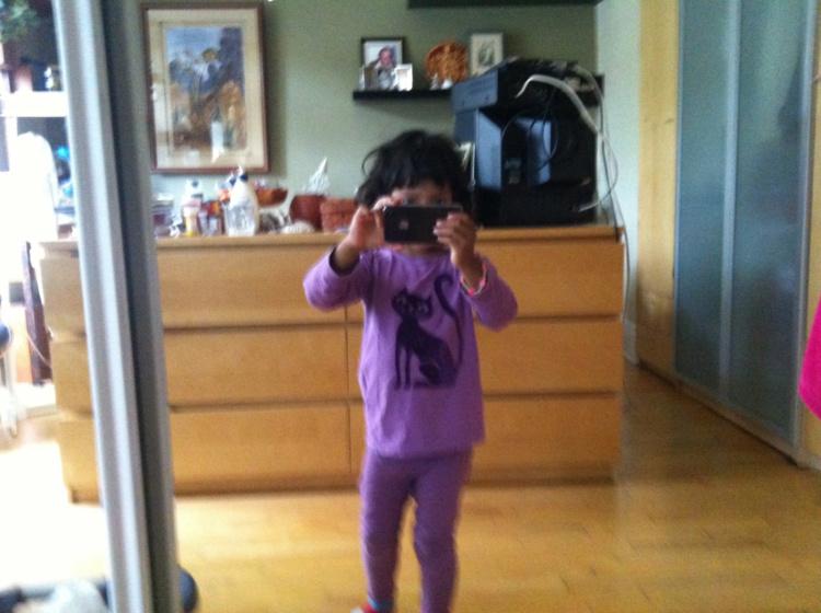 Leena taking a self-portrait in a mirror, c. 2011