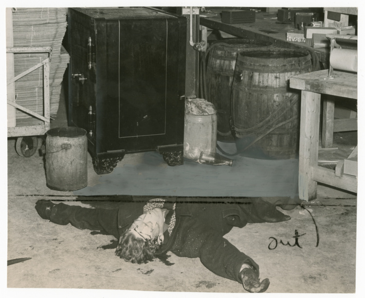 """Unidentified photographer, Dead body of William Poole after he was shot by police while trying to open safe of Toronto Florist Co-operative, 1948. Gelatin silver print, 7 × 8.5"""". Gift of The Globe and Mail newspaper to the Canadian Photography Institute of the National Gallery of Canada."""