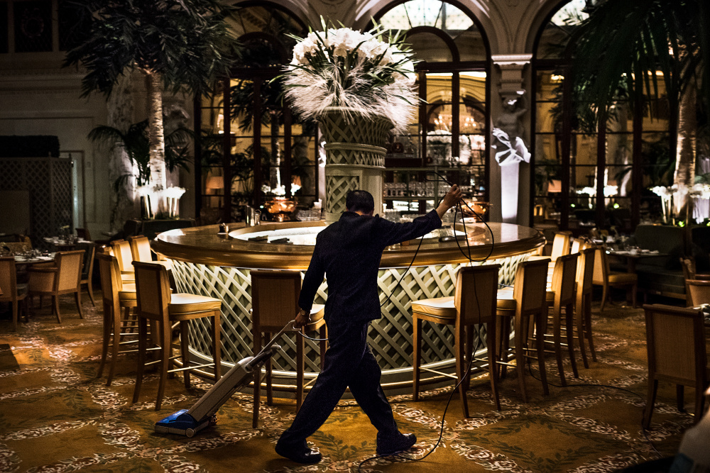 Aaron Vincent Elkaim, Lau Chun-Tai cleans the Palm Court. He has been doing custodial work on the night shift at The Plaza, a Fairmont managed hotel, for 8 years., 2016. Courtesy of NAMARA represents.