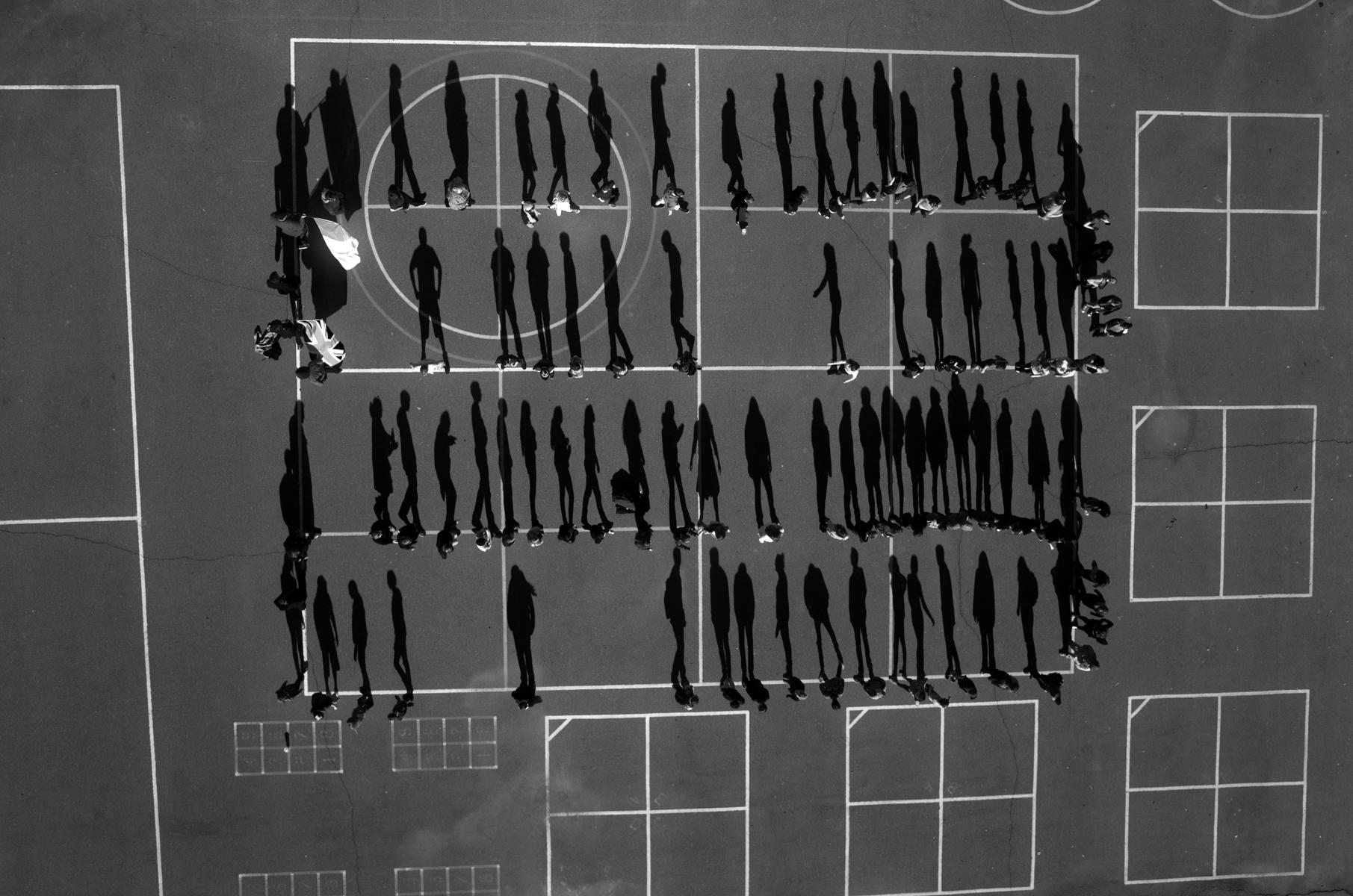 """Tomas van Houtryve, School Yard, 2013 - 2014. Archival pigment print, 40 x 40""""."""