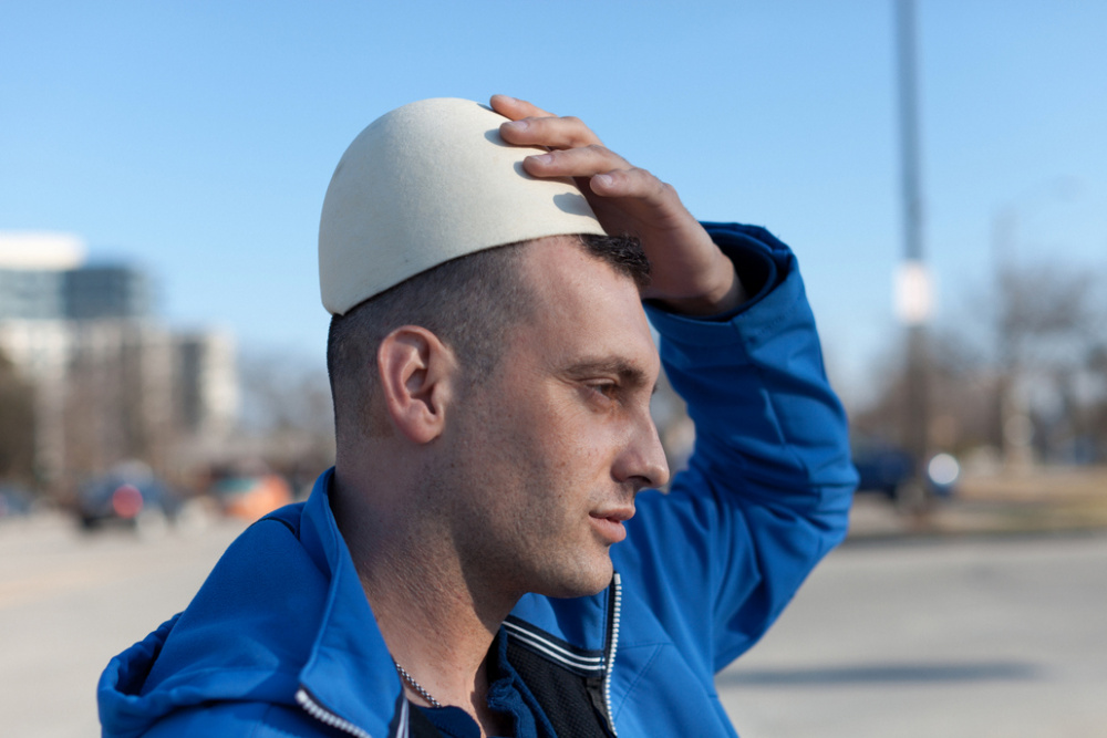 Colin Boyd Shafer, Astrit (Born in Kosovo) wearing a traditional hat called a Plisi, 2014
