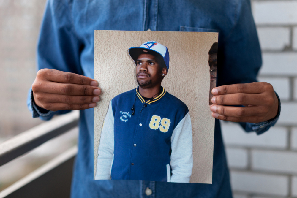 Colin Boyd Shafer, Melvyn (Born in Botswana) holding a photograph of his late brother, 2014