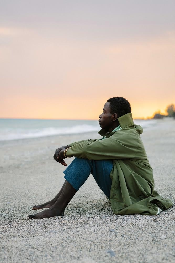 Neil-Anthony Watson, Alieu Kebbeh, a migrant from Gambia sits on the shores of Calabria, 2019