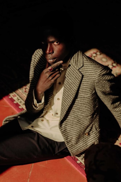 Neil-Anthony Watson, Alieu Kebbeh, a migrant from Gambia sits in an Italian Villa, 2019