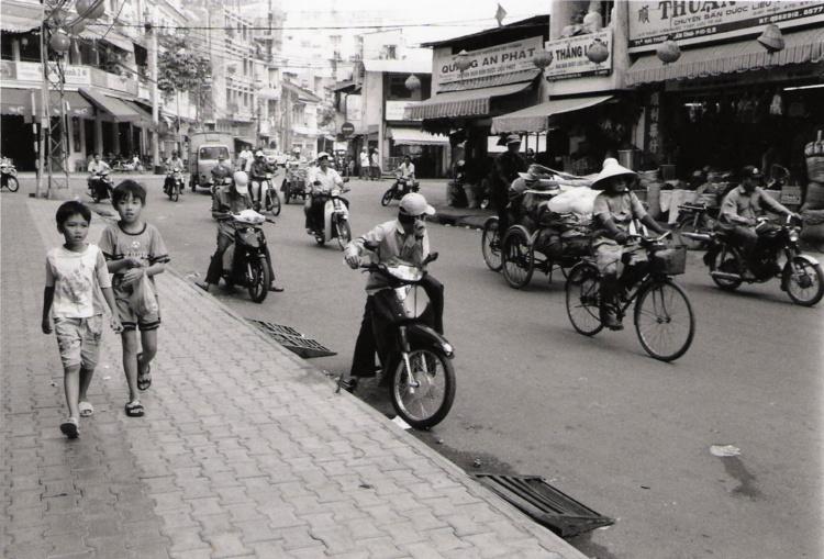Paul Snowdon, Boys Walking in Saigon, 2003, B&W digital print,  11 x 14