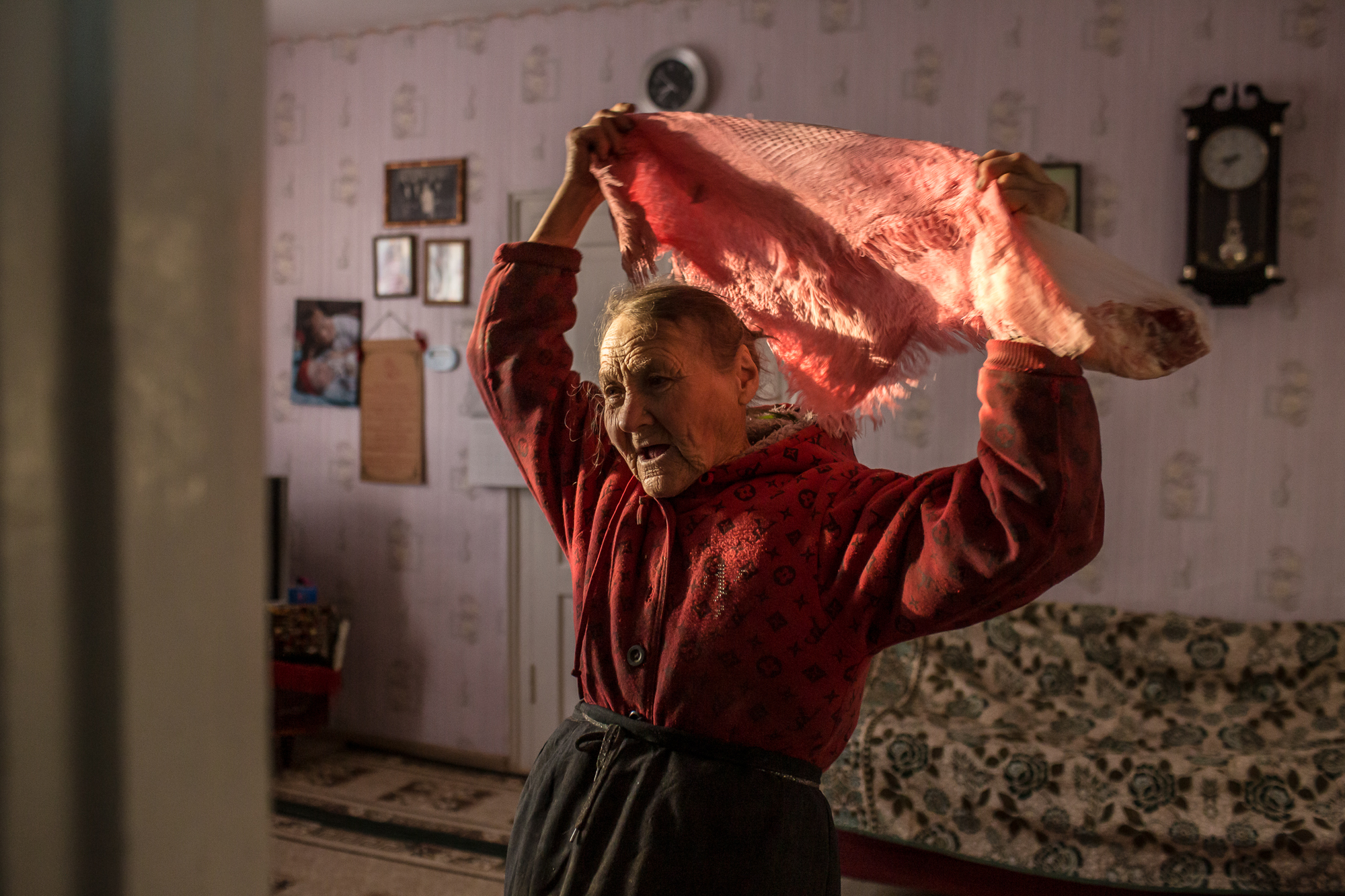 Olha Habro, 76, puts on a scarf in the living room on October 22, 2020 in Borshchiv, Ukraine. Olha Habro was born and grew up in the village of Borshchiv and cooks very tasty borshch with beans. I took this photo for the story about borshch for the NYTimes. Oksana Parafeniuk is an independent photographer based in Kyiv, Ukraine. In addition to her personal projects, Oksana has worked with such international media and organizations as The Washington Post, The New York Times, MSF, UNHCR, Save the Children and others. Oksana co-leads the Women Photograph Kyiv Chapter in Ukraine. Instagram: @oksana_parOksana.paraeniuk@gmail.comwww.oksanaparafeniuk.com, The Journal_Color Theme