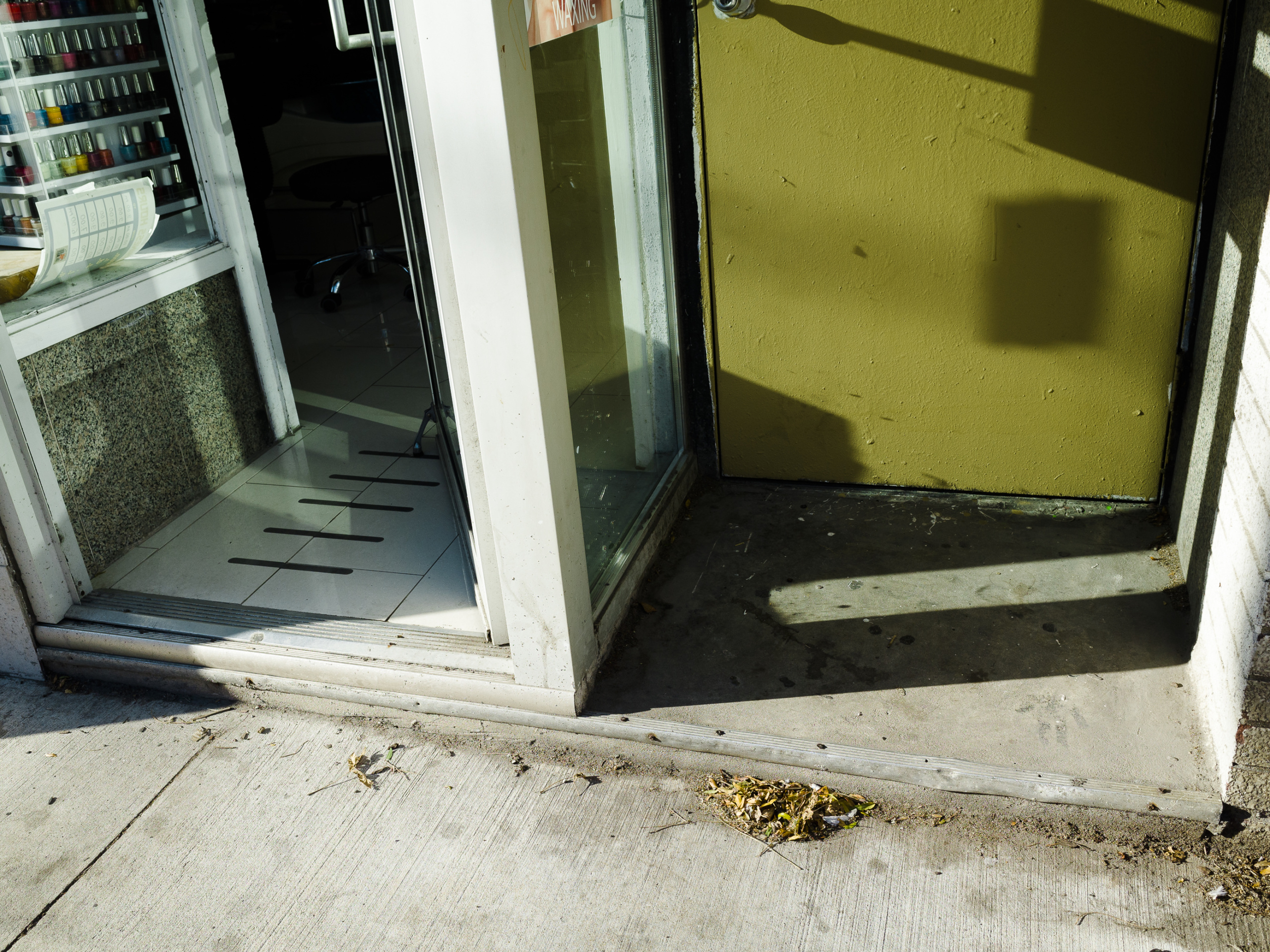 Atanas Bozdarov and Craig Rodmore, Every Step on Queen Street West (concrete, greenish-yellow door, nail polish), 2020