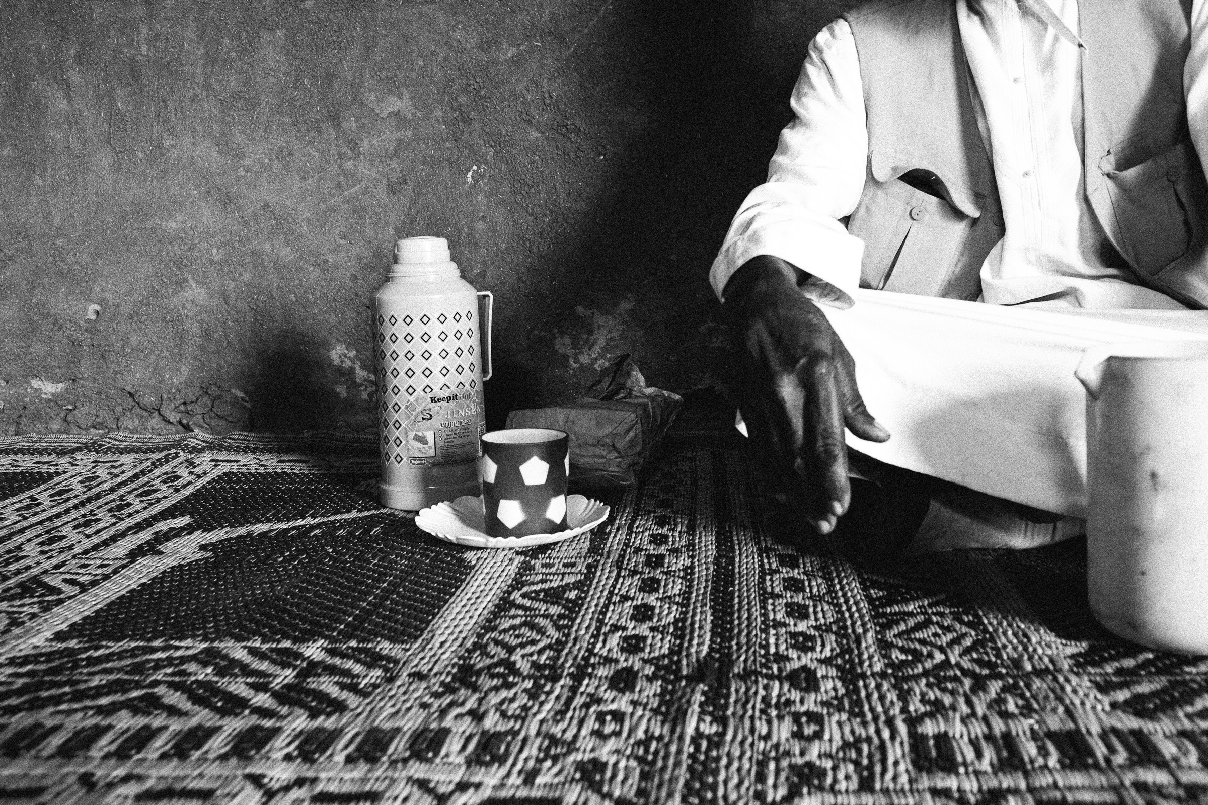 Leyla Jeyte, man sitting beside thermos and cup, 2016. Courtesy of the artist