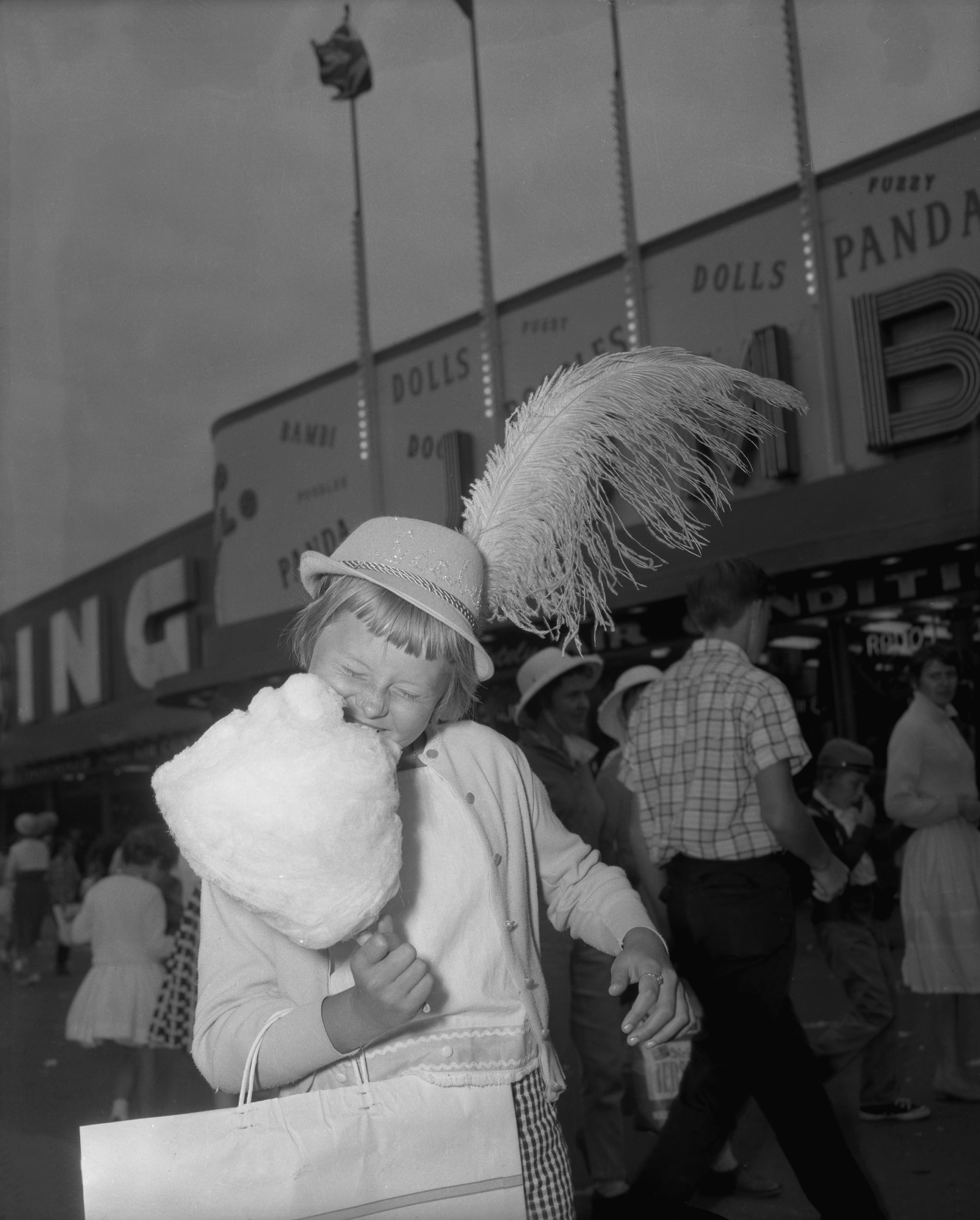 Child Eating Cotton Candy, 1961. Canadian National Exhibition Archives, MG5-F525-I4. Courtesy of the CNEA